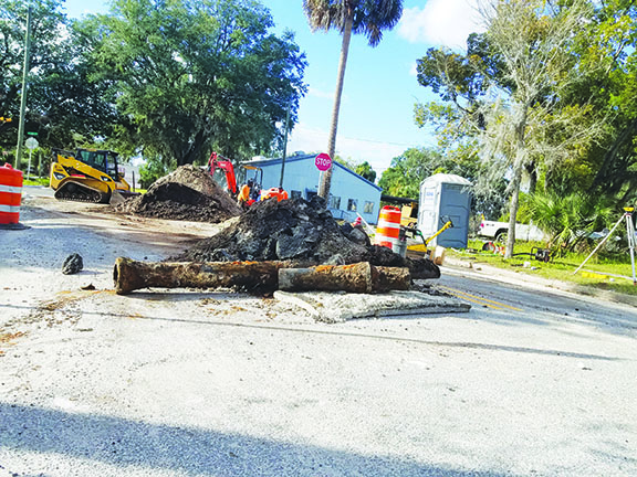 A piece of old, rusted pipe and torn asphalt are piled on Laurel Street in Palatka as Public Works employees perform a drainage construction project earlier this month. More downtown roadwork is planned this year when the city begins repairs and improvements along St. Johns Avenue.