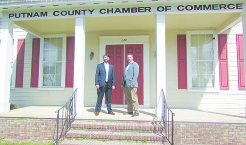 Putnam County Chamber of Commerce Chairman Charlie Douglas and Benjie Bates, the chamber's vice chairman of emerging opportunities, stand on the steps of the chamber, which has partnered with Madison Street Strategies to promote Putnam County's three Opportunity Zones