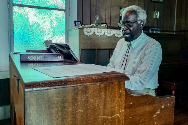 John Alexander plays the organ at St. Mary's Episcopal Church in Palatka.