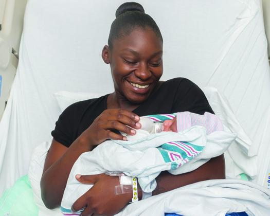 Kymara Boyd and Joziah William Fuller rest in the hospital a day after the child was born.