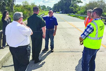 State and local officials discuss the condition of local bridges.