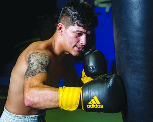 Crescent City High School senior Michael Garcia recently became a professional boxer on his 18th birthday.