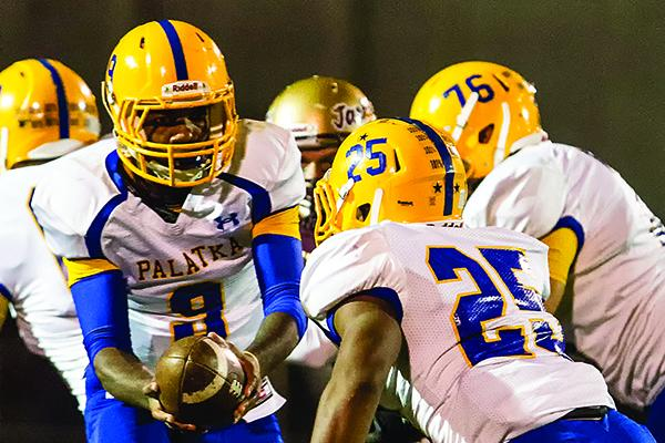 Palatka quarterback De'Abrie Smith hands off to running back Ja'Twan Honor during the 2013 matchup between Palatka and St. Augustine. (JOHN STUDWELL / Special To The Daily News)