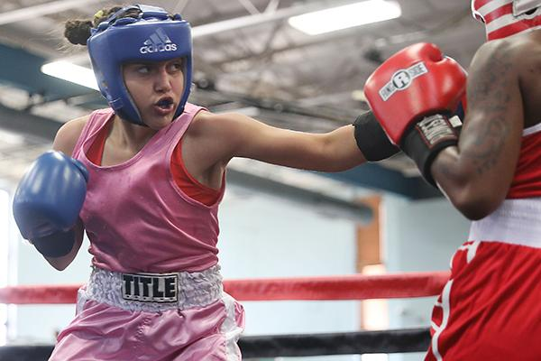 Lozkis Vazquez (left) connects during a Sunday exhibition bout. (ALLISON WATERS-MERRITT / Special To The Daily News)