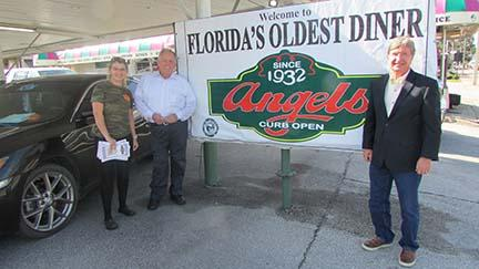 Angel's Diner manager Kayla Davis, left, with longtime customer Tim Smith, center, and Angel's Diner owner John Browning outside Florida's oldest diner.