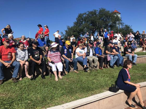 Spectators gather at the riverfront for a ceremony following the Veterans Day parade in Palatka.