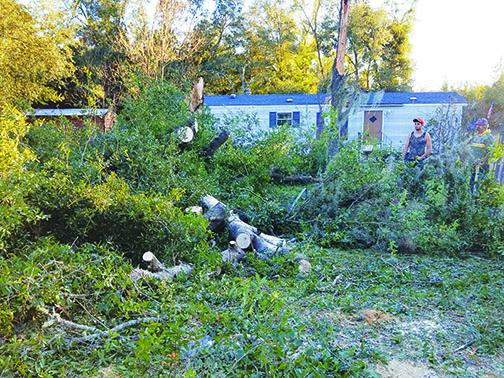 Interlachen residents clean up after a storm ravaged the area.