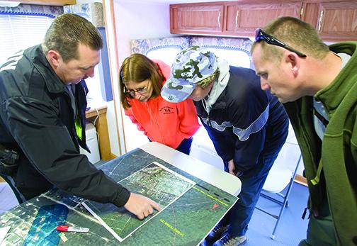 Authorities and volunteers review a map before searching for Haleigh Cummings in 2009.