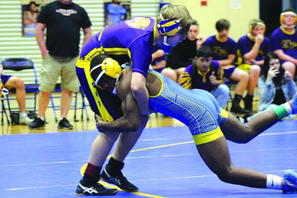 Palatka's Delton Nealy (right) takes down Union County's Johnny Benefield in the 145-pound class. (ANDY HALL / Palatka Daily News)