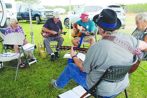 Bluegrass fans make music of their own before the Spring Palatka Bluegrass Festival.