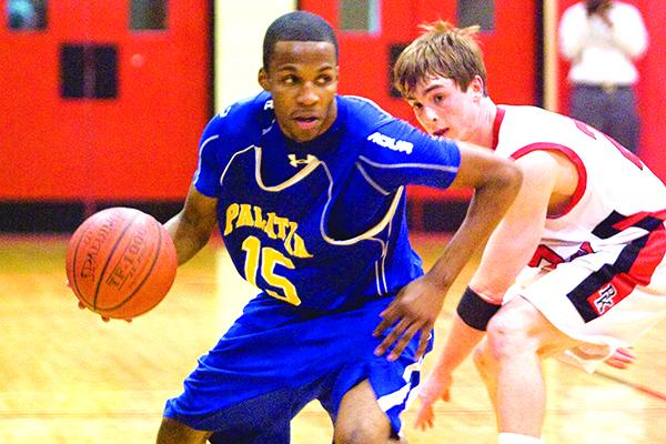 Palatka's Brandon Johnson looks to drive on Jacksonville Bishop Kenny's Travis Pate during the Region 1-4A first-round matchup on Feb. 18, 2010. (Daily News file photo)