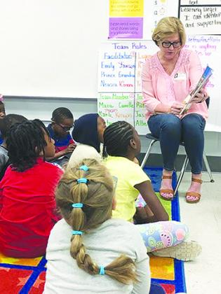School board member Holly Pickens reads to Moseley Elementary School students Thursday during the first Putnam County African-American Read-In.