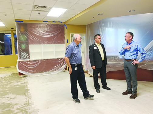Haven Hospice officials Mark Willard, Chris Russell and Clay Dzioba discuss remaining renovations to the Roberts Care Center in Palatka, which was closed last month and is slated to reopen in March.