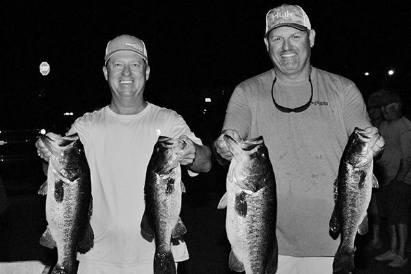 Troy Ward (left) and Tim Mann hold up their winning fish. (GREG WALKER / Special to the Daily News)