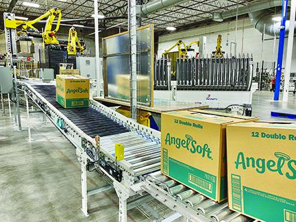 Boxes of Angel Soft bath tissue roll off the conveyor belt at GP's mill in Palatka.