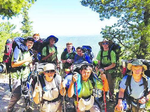 Residents from Rodeheaver Boys Ranch, which is celebrating its 70th anniversary this year, backpack through mountains.