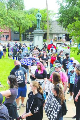 A crowd gathers in front of the Confederate monument at the Putnam County Courthouse at the June 4 protest.