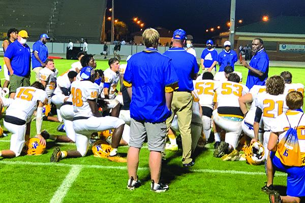 Palatka High School football coach Willie Fells, far right, talks to his players after the Panthers lost to Fleming Island, 29-7, on Friday night. (NICK BLANK / Palatka Daily News)