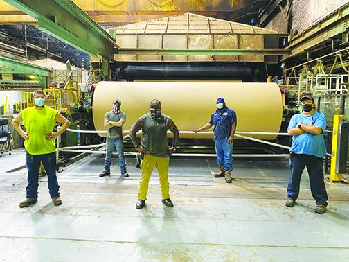 Palatka's Kraft Paper Machine 1 crew members are part of the team making paper for Amazon's new recyclable mailers. From left are William Parrish, Justin Boyd, Samad Green, Cedric Wright and Tim Wilkinson.