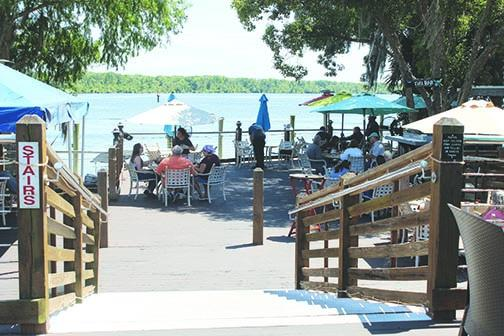Patrons enjoy lunch outside at Corky Bell's restaurant in East Palatka earlier this year when state restrictions limited the amount of indoor seating a restaurant could offer.