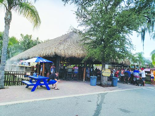 The Tiki bar area at Renegades on the River in Crescent City provides outdoor seating for customers. Restaurants and other businesses in the county will no longer be restricted to capacity limits implemented because of COVID-19.
