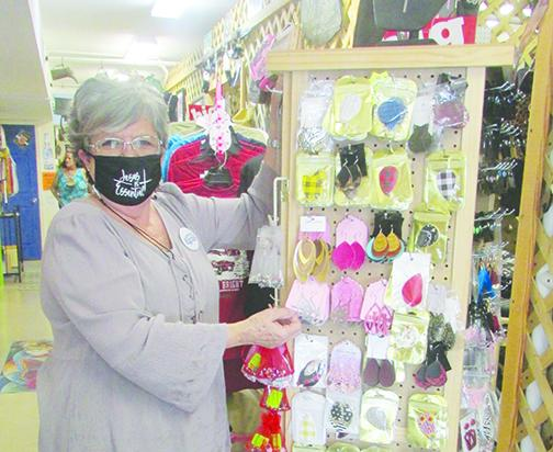 Lynda Williams, owner of Lynda's Sassy Snaps in downtown Palatka, displays some of the merchandise at her store.