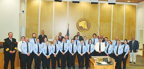 New Putnam County Fire and Emergency Medical Services recruits smile after their pinning ceremony Monday night.
