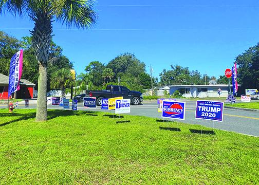 Political signs line the lawn in front of the Elections Office in Palatka on Friday, the day before early voting in Putnam County ends.