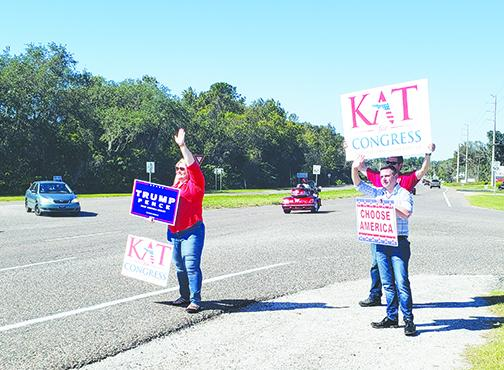 U.S. House candidate Kat Cammack waves at potential voters driving through East Palatka on Election Day. She would go on to win a first term in Congress.