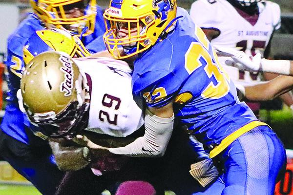 Palatka's Trace Ogle (32) makes the tackle on St. Augustine High running back Zahki James during the fourth quarter of Friday night's game. (EVALENA DAVIS / Special To The Daily News)