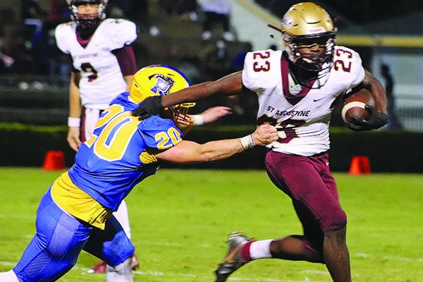 St. Augustine High running back Aaron Wynn breaks free from a tackle attempt by Palatka's Jamie Crouse during the first half Friday night. (EVALENA DAVIS /Special To The Daily News)