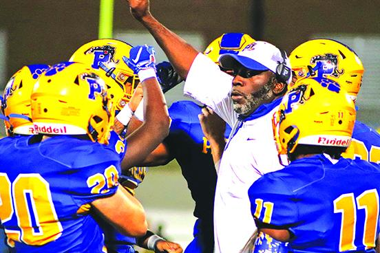 Palatka High School football coach Willie Fells talks to his players during a time out last Friday night. (EVALENA DAVIS / Special To The Daily News)