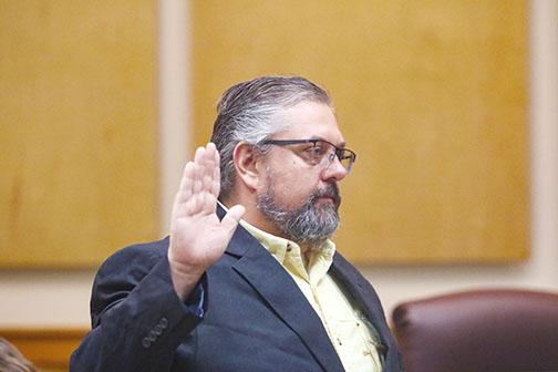 County Commissioner Paul Adamczyk is sworn in Tuesday at the Putnam County Government Complex.