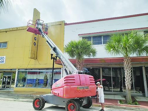 The Bingo Palace exterior in Palatka receives maintenance in hopes of it becoming a new business in 2021.