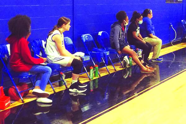 The Interlachen High School's girls basketball team has just one substitute player and a number of empty seats as Rams coach Kim Troiano (far right) watches the action Thursday night against Orange Park Ridgeview. (MARK BLUMENTHAL / Palatka Daily News)