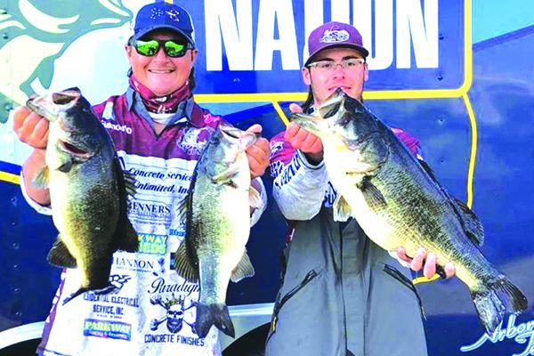 Aaron Yavorsky, left, and Jett Stanley show off their winning catches during the third annual North Regional Junior Bass Tournament for high school students on Sunday at the Palatka docks. (Submitted / GLENN CALE)