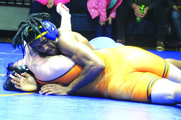 Palatka's Vincent Washington (top) works on getting his eventual pin against Orange Park's Cesar Contreras during Tuesday night's match. (MARK BLUMENTHAL / Palatka Daily News)