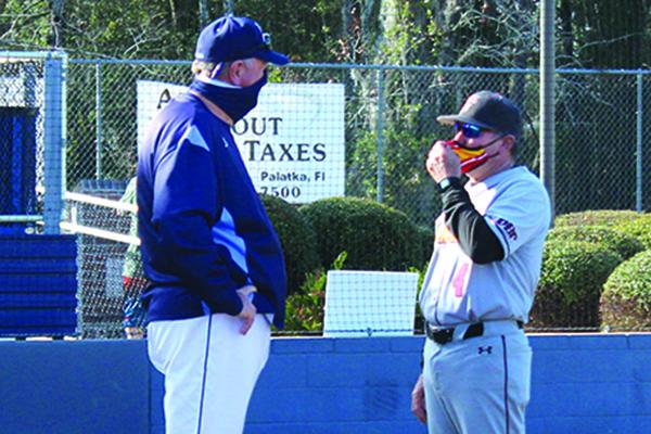 St. Johns River State College baseball coach Ross Jones, left, talks with Flagler College coach Dave Barnett after the Saints beat Jones' Vikings, 6-4, on Saturday. (MARK BLUMENTHAL / Palatka Daily News)
