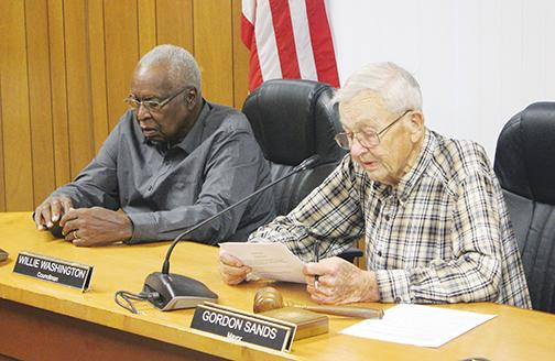 Mayor Gordon Sands, right, and Councilman Willie Washington discuss business during a Welaka Town Council meeting in 2019.