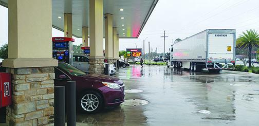 Motorists fuel up at RaceTrac in Palatka on Friday. Gasoline prices have increased about 14 cents per gallon statewide after winter storms forced refineries in Texas to close.