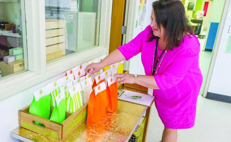 Lara Shettel arranges goodie bags for her fourth-grade class at Browning-Pearce Elementary School last week as she gets ready for the beginning of the new school year.