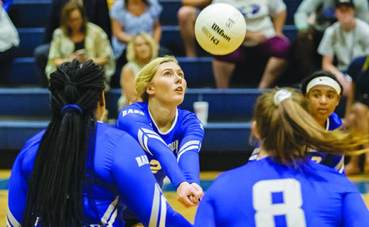 Interlachen High School's Kirby Mason (2) pops the ball back over the net in the first set of their match against Palatka.