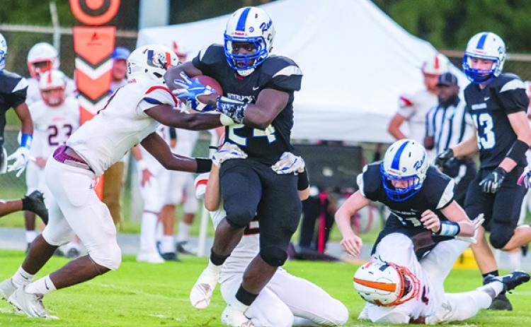 Interlachen's D.J. Polite runs through a series of arm tackles for 78 yards and a touchdown on the Rams' first play. (FRAN RUCHALSKI / Palatka Daily News)