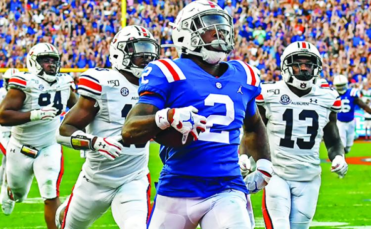 Florida's Lamical Perine completes an 88-yard touchdown run in the fourth quarter. (JOHN STUDWELL / Special To The Daily News)
