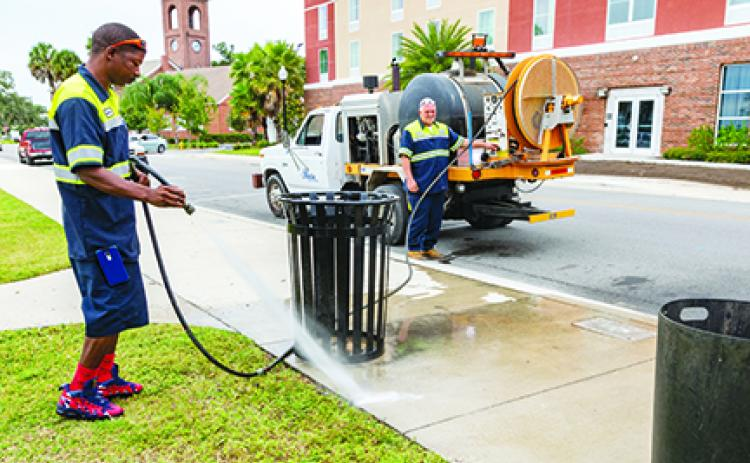 Palatka workers clean up nonresidential areas of the city.