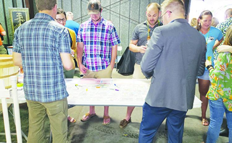 Visitors at Saturday's Palatka Craft Beer Festival discuss ideas for downtown development as part of the St. Johns Avenue Streetscape Project.
