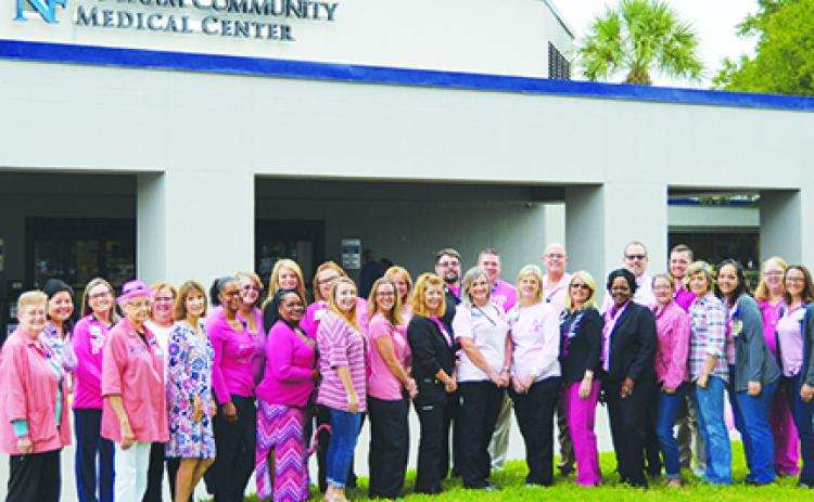 Hospital staff dress in pink to promote breast cancer awareness.