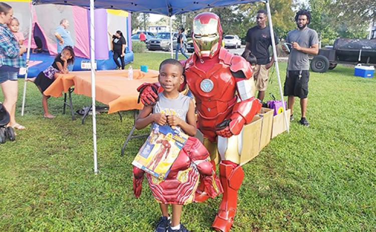 Children receive Halloween costumes during Costumes for Kids.