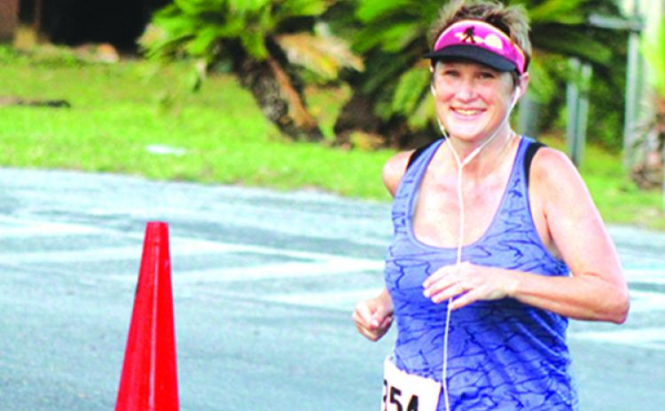 Palatka's Lori McCarthy runs a lap in the 24-hour portion of the Azalea 12/24 road race Saturday at Ravine Gardens. (MARK BLUMENTHAL / Palatka Daily News)