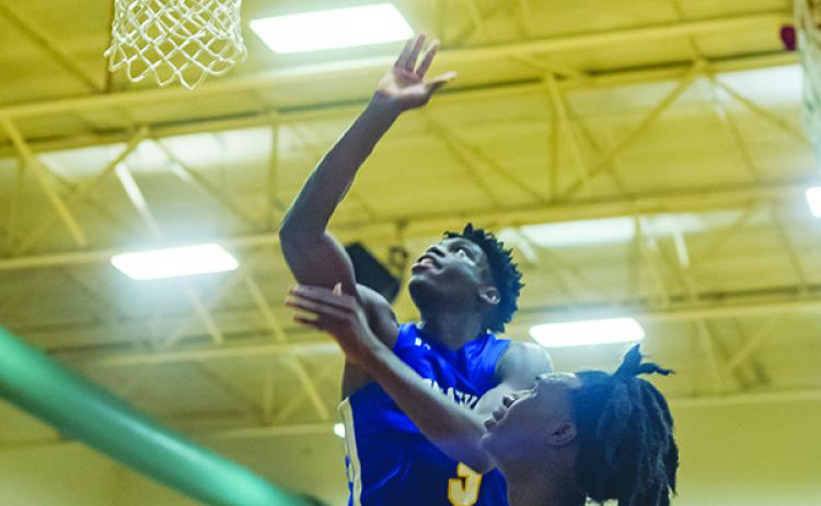 Palatka's Malik Beauford drives for the winning basket at Eastside. (Daily News file photo)